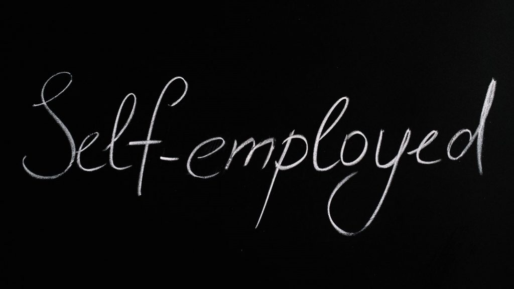 chalkboard that says self employed