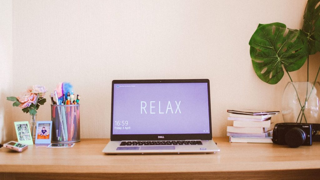 cool desktop with a laptop screen that says relax