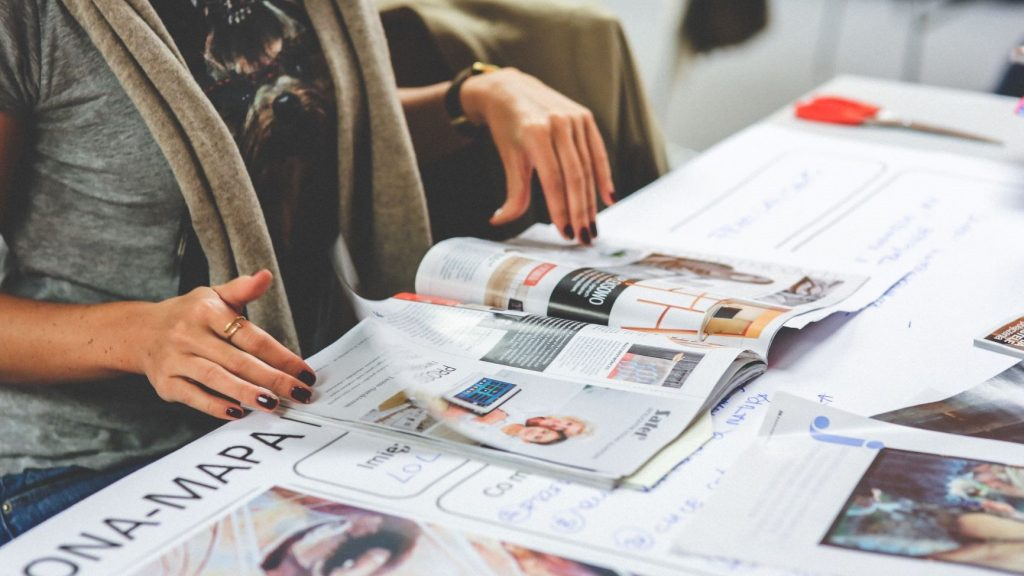graphic designer looking at a magazine