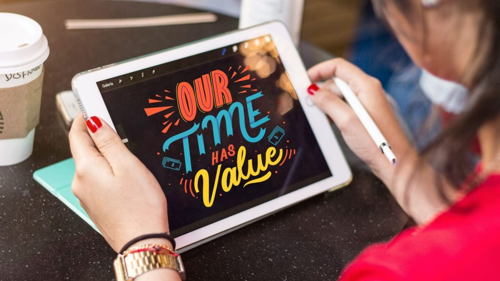 woman holding tablet that says our time has value
