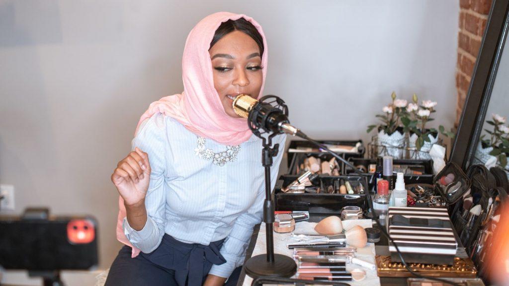 woman recording a makeup podcast